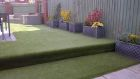 Child friendly garden transformation with composite Eco decking and artificial grass <br /><br />www.heysgroundcare.co.uk