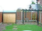 Pergola over corner patio with bamboo screening for the wooden shed<br />www.heysgroundcare.co.uk
