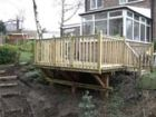 Bespoke elevated decking overlooking woodland garden www.heysgroundcare.co.uk